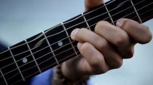 Michael Mattice hand and strings from video