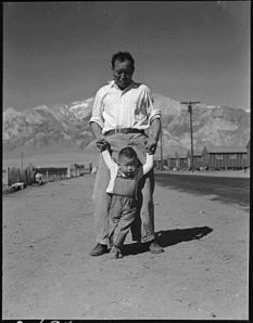 Dorothea Lange- Grandfather with grandson  at Manzanar CA Camp