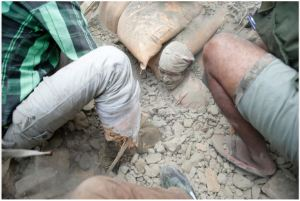 Nepalese man Trapped in Rubble Photo by Narandra Shresta
