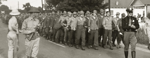 POWs Marching to camp in Aliceville Alabama